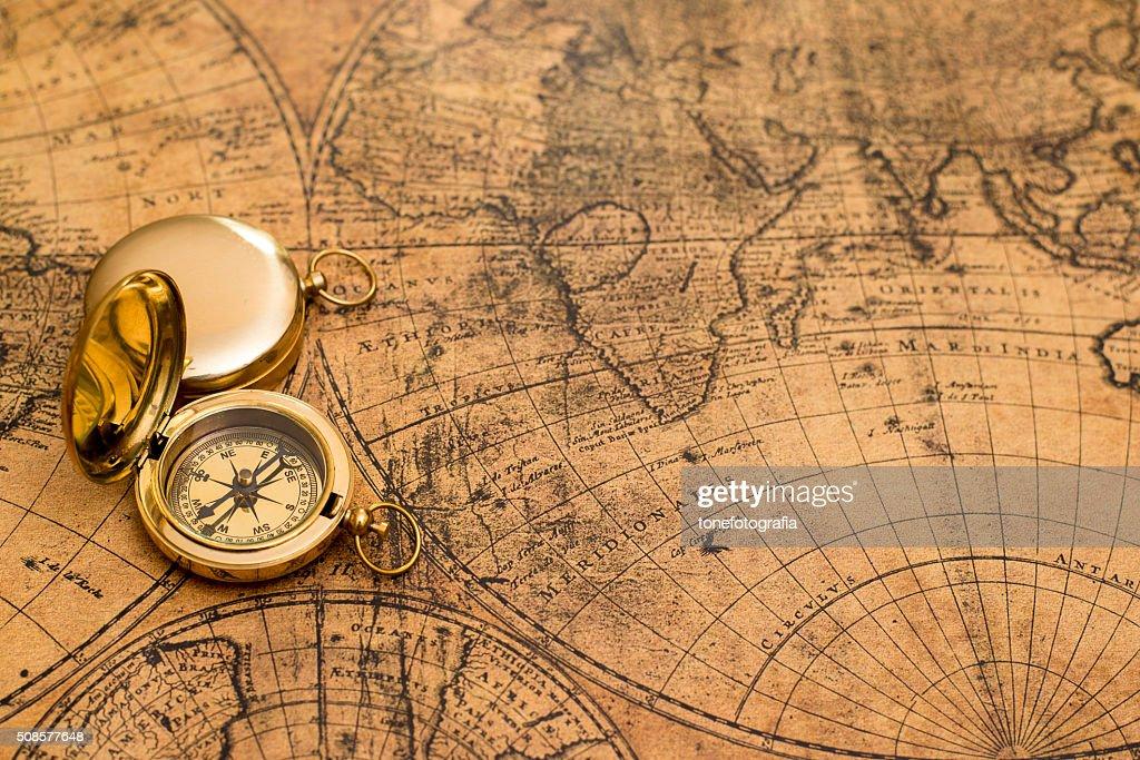 old compass  on vintage map : Bildbanksbilder