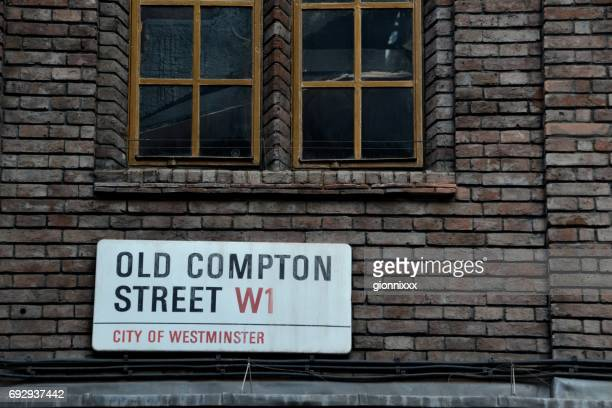 old compton street sign, soho, london, uk - west end london stock pictures, royalty-free photos & images