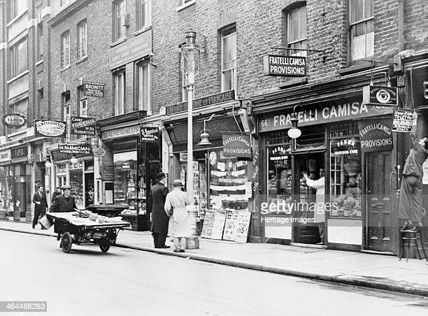 Old Compton Street Soho London The street is lined with food shops including the Italian delicatessen Fratelli Camisa A man makes his way down the...
