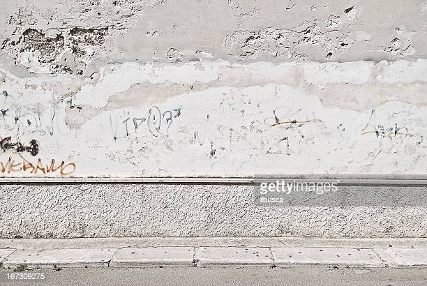 old concrete grunge wall with sidewalk - brick wall stock pictures, royalty-free photos & images