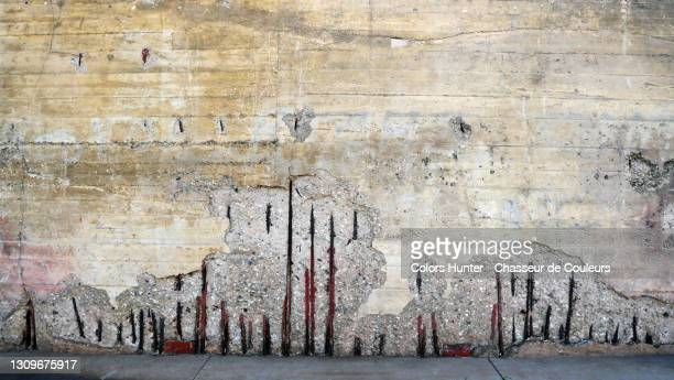 old concrete wall with rusty metal of an abandoned bunker in france - war and conflict stock pictures, royalty-free photos & images