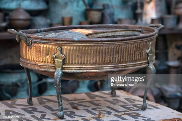 old copper barbeque for sale in a shop. - emreturanphoto stock pictures, royalty-free photos & images