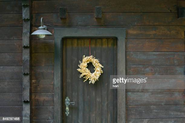 Old Country Wooden House with Flower Ring Decoraction