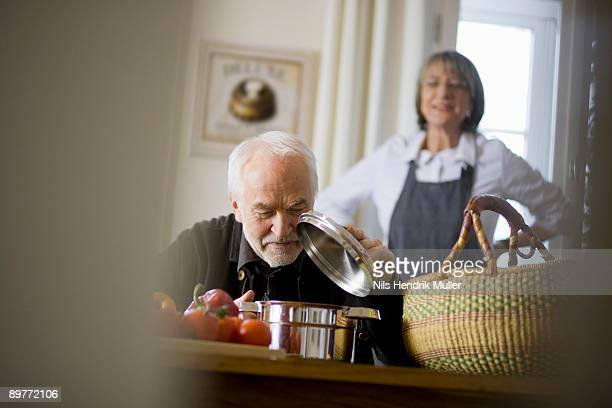 old couple cooking