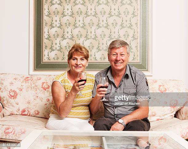 Old couple drink wine