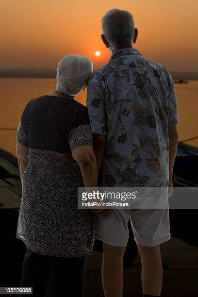 Old couple enjoying the sunset