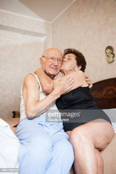 old couple in love - black women kissing white men stock pictures, royalty-free photos & images