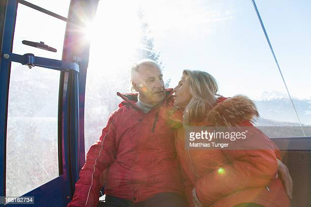 Old couple sitting in a gondola lift