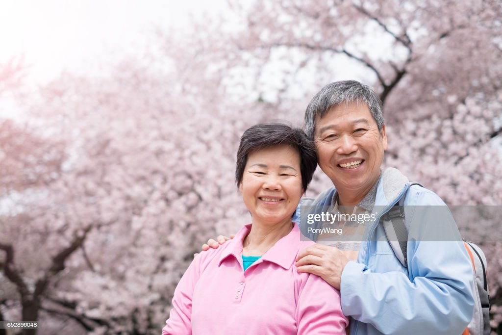 Old couple smile to you : Stock Photo