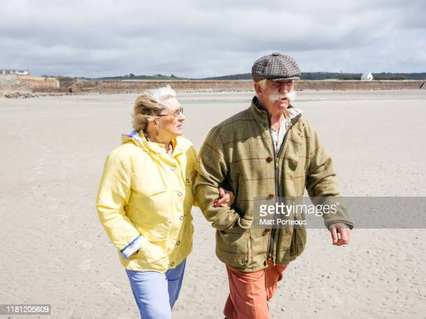 old couple walking - husband stock pictures, royalty-free photos & images