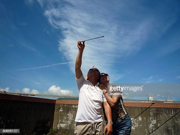 Old couple wtaching eclipse together