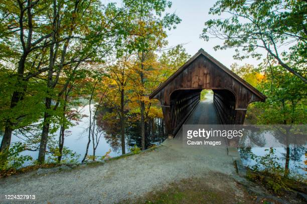 old covered bridge in new england fall - covered bridge stock pictures, royalty-free photos & images