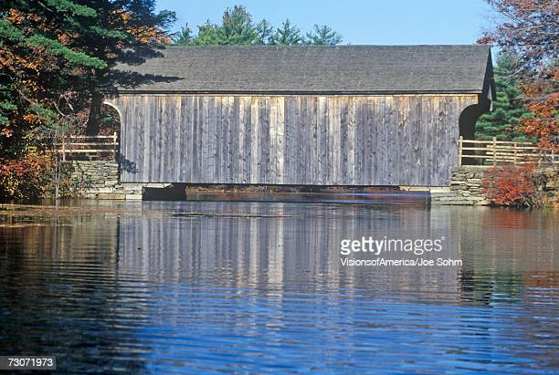 """old covered bridge, sturbridge, massachusetts"" - sturbridge stock photos and pictures"