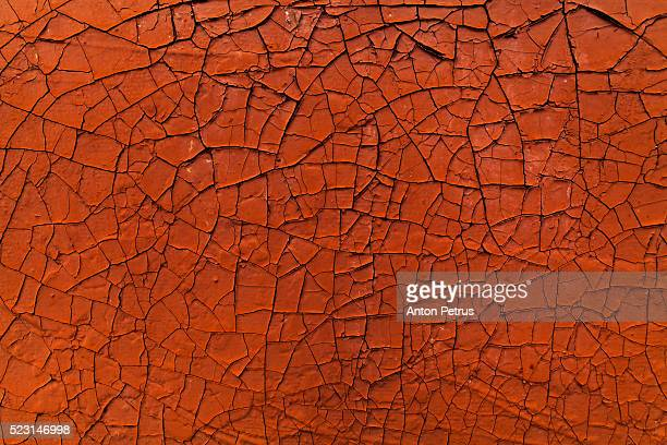 Old cracked paint. Orange abstract background.