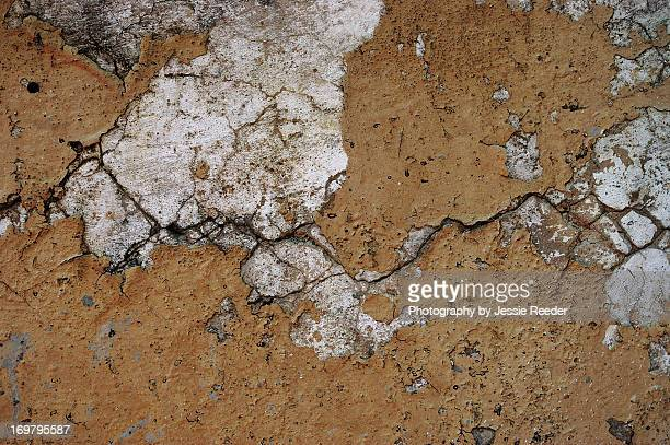 Old cracked wall with peeling paint