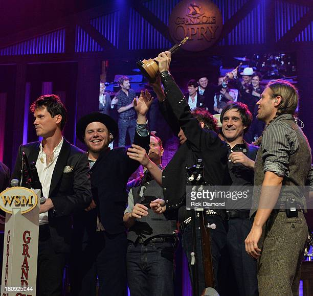 Old Crow Medicine Show during their induction at The Grand Ole Opry on September 17 2013 in Nashville Tennessee
