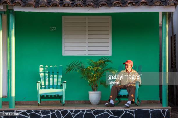 old cuban man on terrace, vinales, cuba - pinar del rio stock photos and pictures