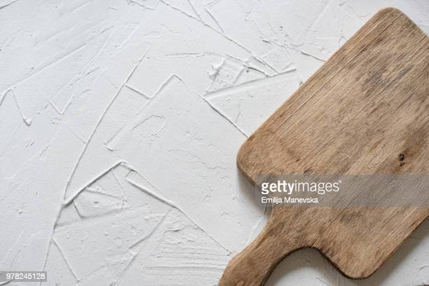 old cutting board on white vintage background - chopping board stock pictures, royalty-free photos & images