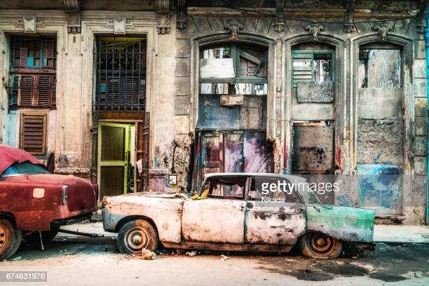 old damaged vintage car on the street of old havana, cuba - run down stock photos and pictures