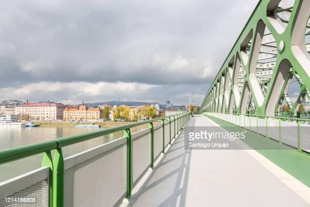 old danube bridge in bratislava - slovakia stock pictures, royalty-free photos & images