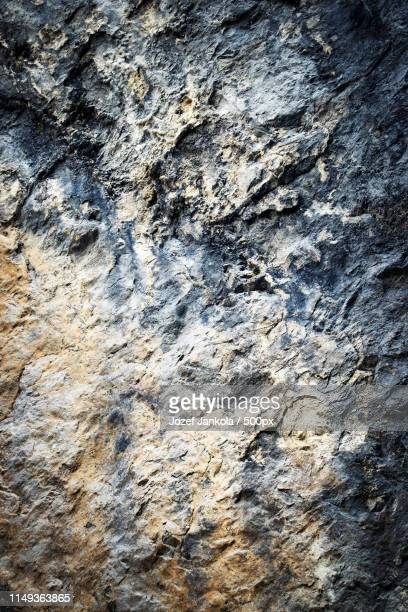 old dark limestone rock - bedrock stock pictures, royalty-free photos & images