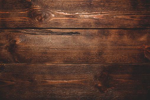 Old dark wooden surface 1085004340
