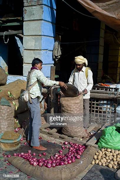 Old Delhi Daryagang fruit and vegetable market with red onions and potatoes on sale India