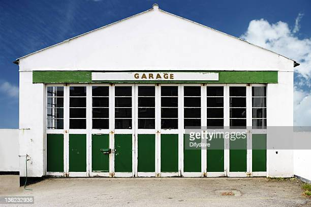 old deserted auto repair garage against blue sky - auto repair shop exterior stock pictures, royalty-free photos & images
