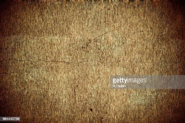old dirty cracked grungy background texture in brown - old parchment background burnt stock photos and pictures