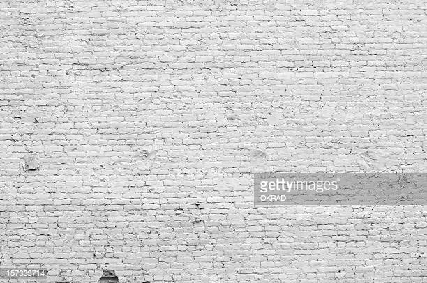 old distressed white brick wall - brick stock pictures, royalty-free photos & images