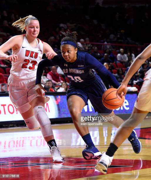 Old Dominion Lady Monarchs forward Odegua Oigbokie drives the lane past Western Kentucky Lady Toppers forward Ivy Brown during the first period of...