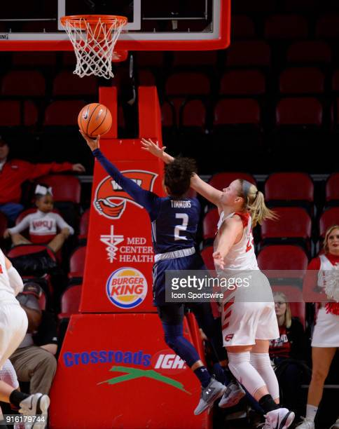 Old Dominion Lady Monarchs guard MaKayla Timmons shoots over the out stretched arms of Western Kentucky Lady Toppers forward Ivy Brown during the...
