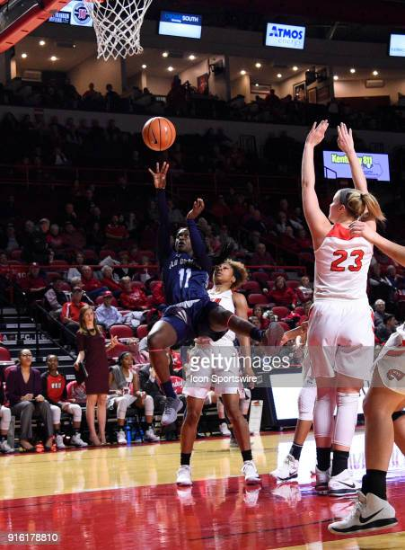 Old Dominion Lady Monarchs guard Taylor Edwards shoots over Western Kentucky Lady Toppers guard Alexis Brewer during the first period of the Old...