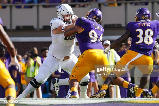 Old Dominion Monarchs guard AJ Davison blocks East Carolina Pirates defensive tackle Alex Turner during a game between the Old Dominion Monarchs and...
