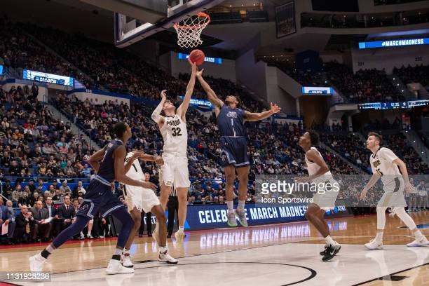 Old Dominion Monarchs guard Jason Wade battles for a rebound with Purdue Boilermakers center Matt Haarms during the first half of the NCAA Division I...