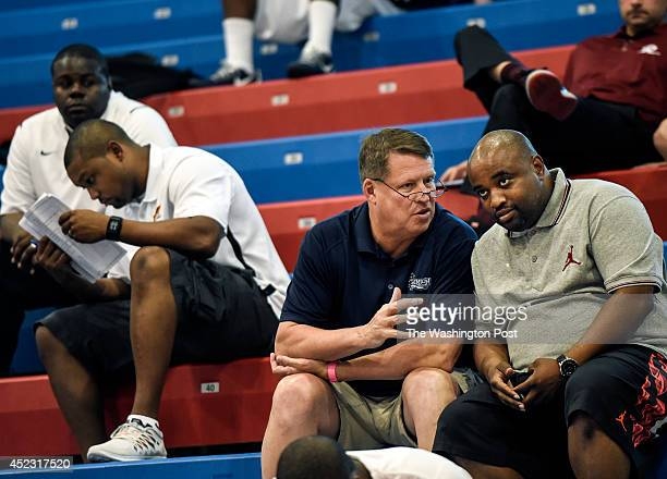 Old Dominion University basketball coach Jeff Jones left talks with Team Takeover Director and Camp Manager Keith Stevens at the Ty Lawson and Victor...
