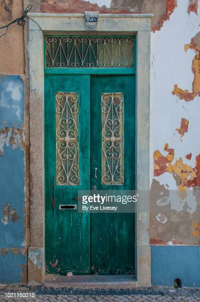 old door in faro town - faro city portugal stock photos and pictures