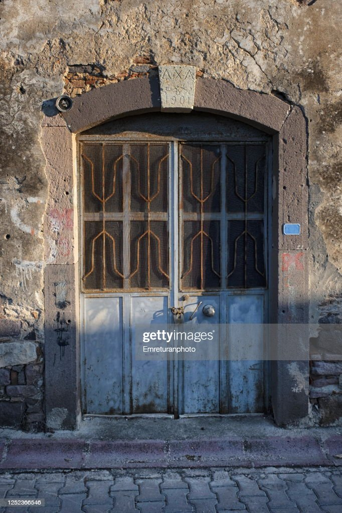 Old door of an abandoned olive oil factory in Ildir,Aegean Turkey. : Stock Photo