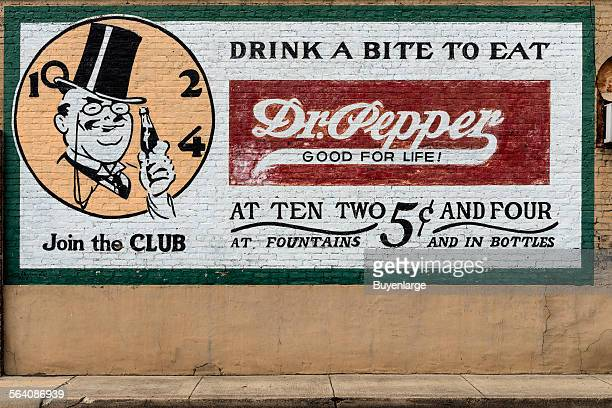 Old Dr Pepper advertising sign on a downtown building in Pittsburg Texas