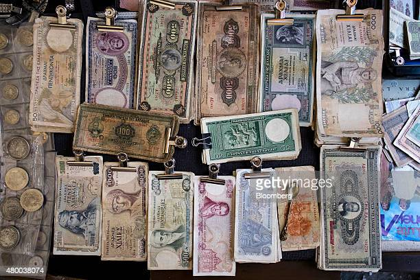 Old drachma banknotes sit on display on the counter of an antique store in Thessaloniki Greece on Thursday July 9 2015 Greece is rushing to pull...