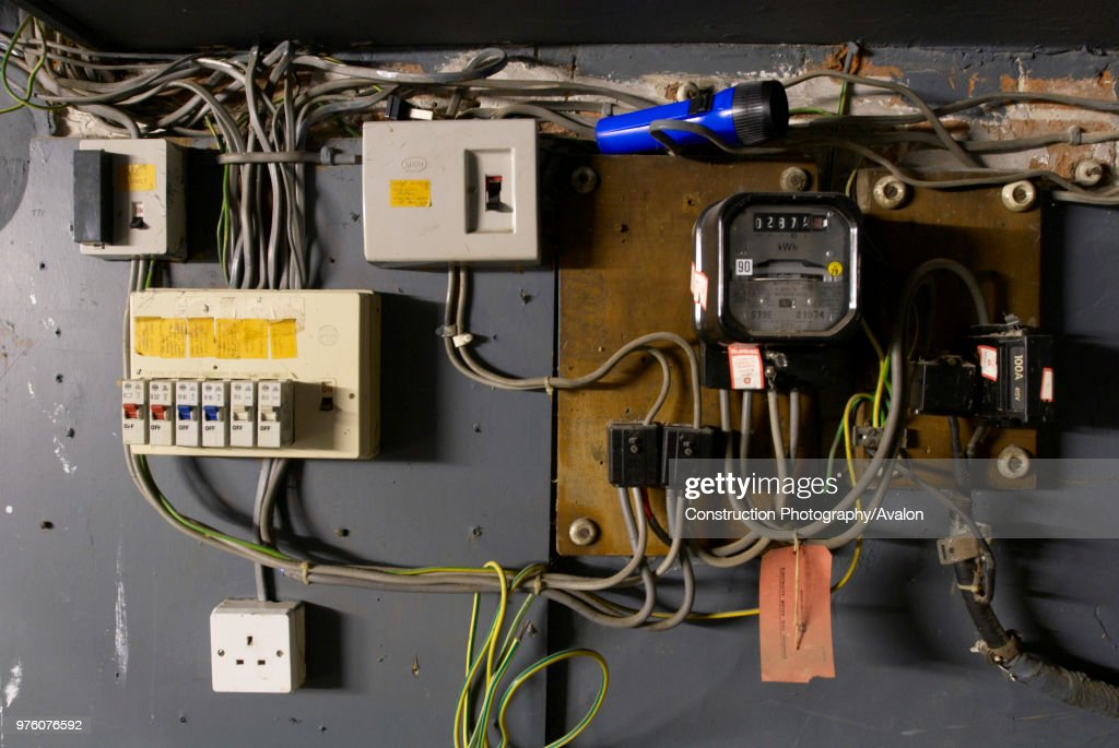 Old electrical installation with switch box, meter and fuse box ...