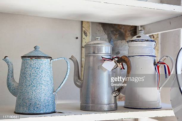 old emaile coffecans on a shelf - enamel stock pictures, royalty-free photos & images