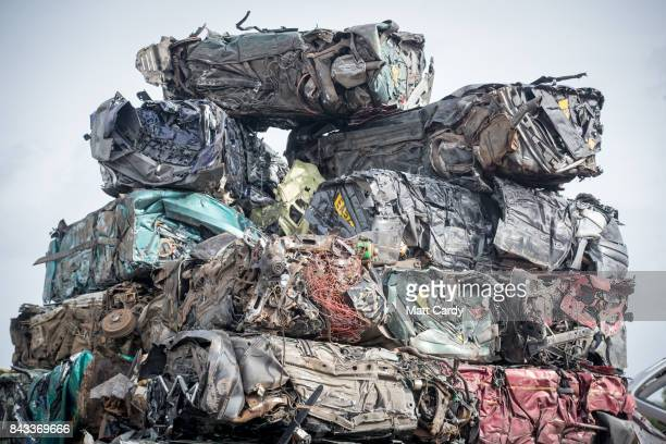 Old endoflife scrap cars and vans that have been crushed wait to be collected at Pylle Motor Spares and Metal Processing a licensed scrap yard in...