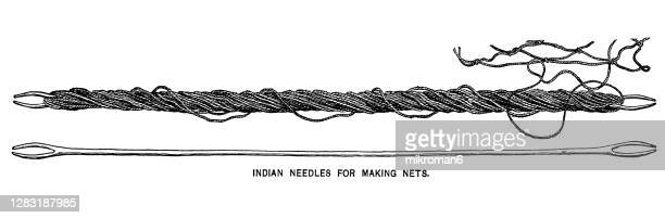 old engraved illustration of indian needles for making nets - needlecraft stock pictures, royalty-free photos & images