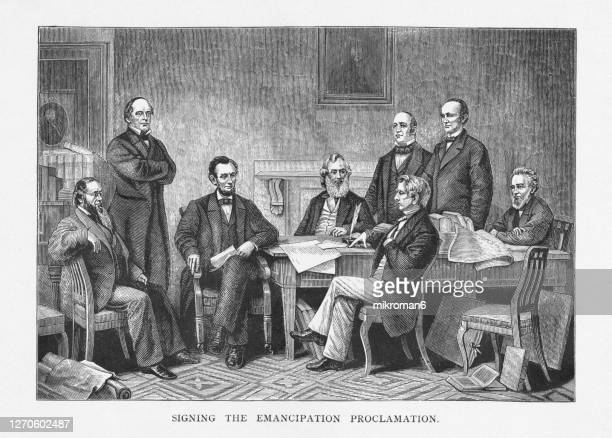 old engraved illustration of the signing of the emancipation proclamation - american civil war stock pictures, royalty-free photos & images