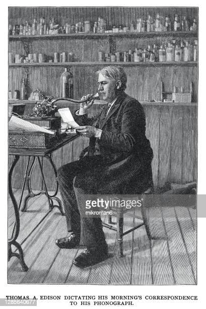 old engraved illustration of thomas alva edison (1847-1931) dictating his morning's correspondence into a phonograph in his lab - diplomacy stock pictures, royalty-free photos & images