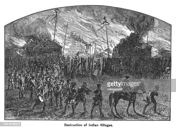 old engraving illustration of destruction of indian villages - war and conflict stock pictures, royalty-free photos & images