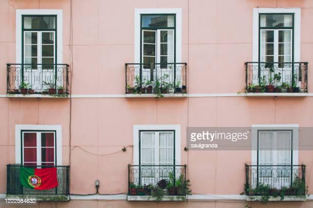 old facade with portuguese flag - bandeira de portugal imagens e fotografias de stock