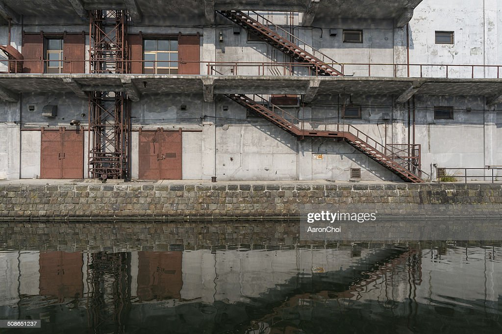 Old factory building along the canal : Stock Photo