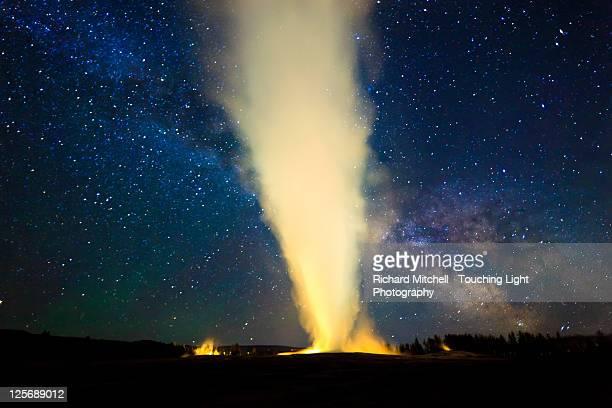Old faithful geyser and milky way